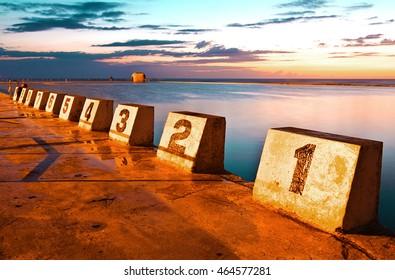 Merewether Ocean Baths bathed in golden sunrise light