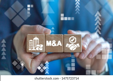 Merger and Acquisition Business Corporate Cooperation Company concept. M&Q partnership concept on wooden dices in businessman's hands.