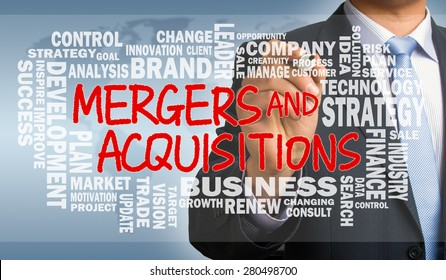 mergers and acquisitions concept with business word cloud handwritten by businessman