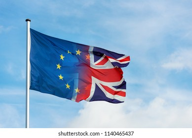 Merging european and british flag in front of blue sky as a symbol for the Brexit
