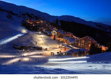 MERIBEL - MOTTARET, FRANCE - JANUARY 24, 2018: preparing the slopes of ski resort Meribel - Mottaret, part of Les 3 vallees at night.