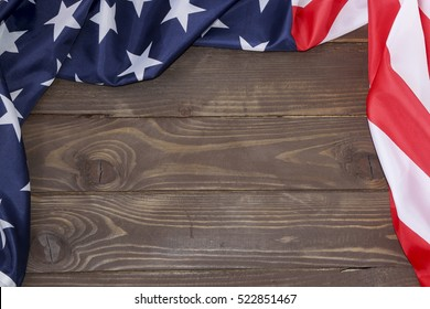 merican flag wooden background.The Flag Of The United States Of America. The place to advertise, template.The view from the top.