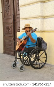 Merida, Mexico - April 21, 2019: Disabled musician making a living by busking on the streets of Mexico.