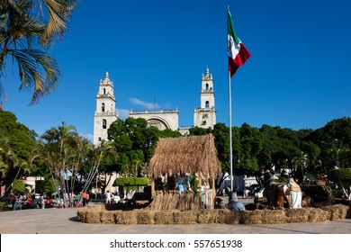 MERIDA, MEXICO - DECEMBER 30 2016: Nativity scene on the Plaza Grande in Merida with the San Ildefonso Cathedral in the background.