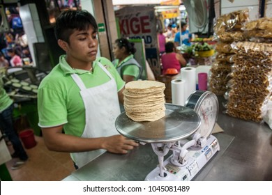 MERIDA, MEXICO - march 11, 2012: Vendor selling maize or corn tortillas on  a local market in Merida, Yucatan, Mexico