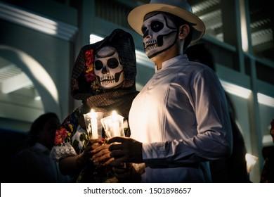Merida, Mexico - October 29 2018: Painted dancers portrait with Catrina skulls for dia de los muertos before the show on Palacio Municipal at Festival de las Animas
