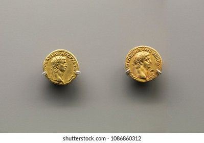 Merida, Spain - December 20th, 2017: Two golden coins of Claudius Emperor at National Museum of Roman Art in Merida, Spain