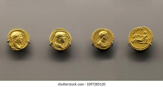 Merida, Spain - December 20th, 2017: Hadrian Emperor four gold coins, National Museum of Roman Art in Merida, Spain