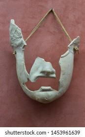 Merida, Spain - December 20th, 2017: Incomplete roman theatre mask in stucco at National Museum of Roman Art in Merida, Spain