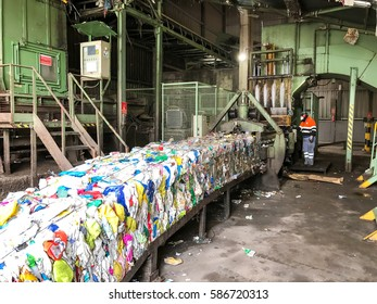 Merida, Spain - February 24, 2017: industry of recycling, recycling machine operator working