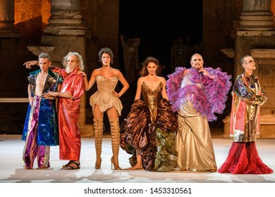 """Merida, Spain - July 15, 2019: 65th Edition of the International Festival of classical theatre in Merida. play """"Dionysus"""" by company of Rafael Amargo. Greetings from the dressed actors"""