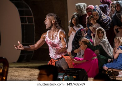Merida, Spain - June 24, 2019: 65th edition of the International Classic Theater Festival of Mérida. opera Samson and Delilah. The singer Noah Stewart surrounded by extras, represents Samson