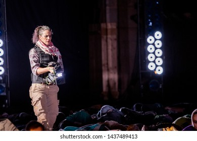 Merida, Spain - June 24, 2019: 65th Edition of the International Festival of classical theatre in Merida. Opera Samson and Delilah. actress representing a journalist at a moment of representation