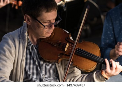 Merida, Spain - June 24, 2019: 65th Edition of the International Festival of classical theatre in Merida. Representation of the classic opera Samson and Delilah. violinist playing in orchestra