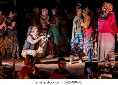 Merida, Spain - June 24, 2019: 65th edition of the International Classic Theater Festival of Mérida. Opera Samson and Delilah. Actress acting as journalist and extras during the performance.
