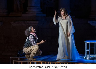 Merida, Spain - June 24, 2019: 65th Edition of the International Festival of classical theatre in Merida. Opera Samson and Delilah.The singer María José Montiel during a scene singing