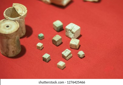 Merida, Spain - Sept 4th, 2018:  dices and dice cups of ancient roman times. National Roman Art Museum, Spain