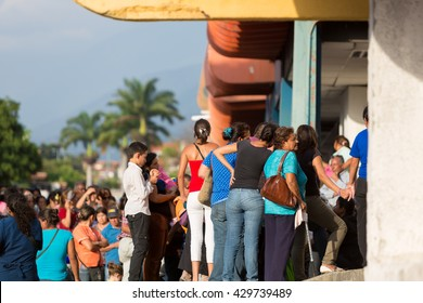 MERIDA, VENEZUELA - APRIL 29: Group of people waiting in line at a public supermarket doors in Merida. With significant inflation, rationing is required in some places in Venezuela in 2015.