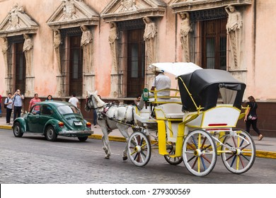 Merida, Yucatan Mexico, March 22, 2015: Horse carriages with passengers on a city street in Merida Mexico.