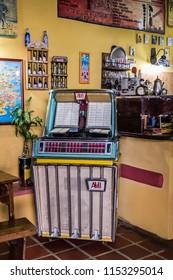 Merida/Venezuela - 12/22/2010: Old jukebox in the corner of a canteen