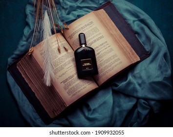 MERIDA-YUCATAN-MEXICO-DECEMBER-2020: Tom Ford Black Orchid perfume bottle on old tax law book and blue cloth.