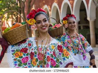 Merida,Yucatan/Mexico-February 29,2020:female folk dancers in traditional costumes performing the fruit basket dance