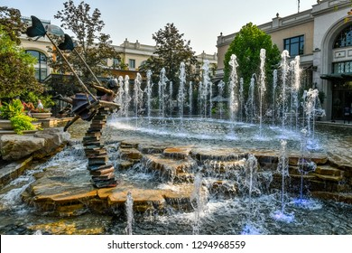 Meridian, Idaho / USA - August 8 2018: Girl in Fountain statue at Fountain Square in The Village