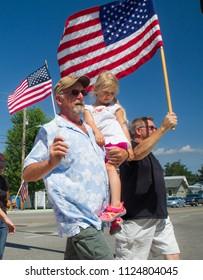 MERIDIAN, IDAHO/USA - JULY 30, 2016: Man holds a girl while marching to the pro police rally in Meridian, Idaho