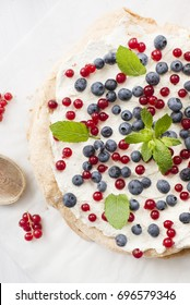 Meringue Cake with redcurrant, blueberries and mint