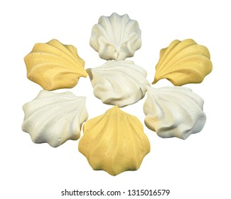 Meringue cakes in the form of shells white and yellow