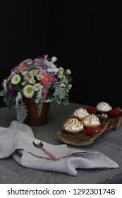Meringue cookies, french dessert, Macaroons, French Meringue Cookies with fruit. Black background