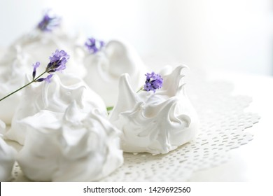 meringue decorated with lavender. French meringue cookies, macro shot.