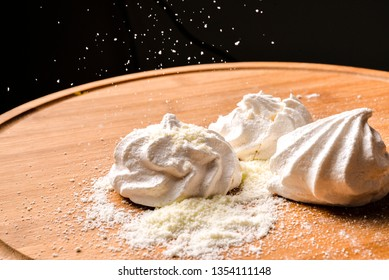 Meringue Delicious homemade meringues on wooden background