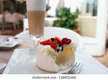meringue with fresh fruit and mango mousse