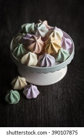 Meringues on white stand with moody feeling to image