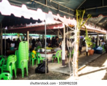The merit making at the temple is a fusion of food, desserts and traditional Thai desserts. Public Donate a lot of money. Abtract blur.