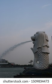 Merlion Park, Singapore on 02.09.2019: Water spitting Merlion, the patron of the Asian city