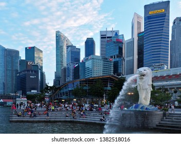 Merlion Park skyscrapers.  Singapore, Asia - June 5, 2016 The national symbol of Singapore Merlion gushing with water against the background of skyscrapers at Merlion Park in Singapore.
