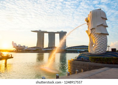 Merlion,Singapore - September 22 2017 :Singapore skyline of financial district with modern office buildings and Merlion Park as seen from Esplanade.