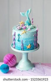 Mermaid birthday cake decorated with seashells