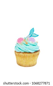 Mermaid cupcake. Buttercream muffin with mermaid and seashells decoration on top. Fairy tales inspiration. Cupcake isolated on white background