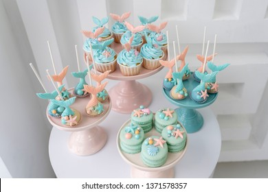 Mermaid cupcakes and cookies in pink and turquoise colors