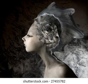 mermaid girl in an unusual headgear, a hat