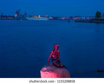 The Mermaid, sculpture, landmark of Copenhagen, in the background the Danish royal yacht Dannebrog, Copenhagen Harbour, Copenhagen, Denmark, Europe, 19. May 2016