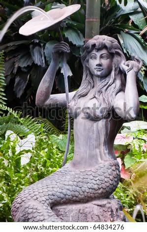 Mermaid Statue In The Garden, Thailand.