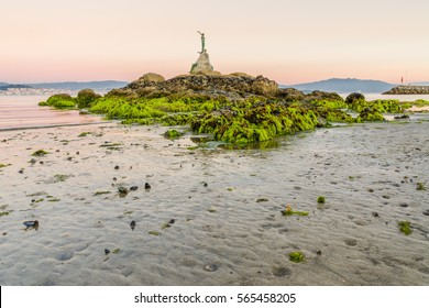 Mermaid statue with low tide in Cangas do Morrazo