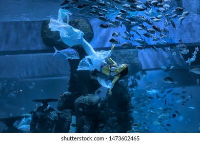Mermaid is swimming with fishes at the Jakarta Aquarium on July 27, 2019.
