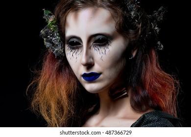 Mermaid. Woman monster. Creative dark make-up, conceptual idea for Halloween. Eerie nightmare turning into a black mermaid