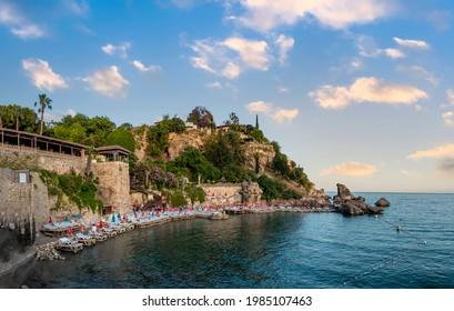 Mermerli Beach view from hill in Antalya City. Coast stone embankment with tall cliff and Mermerli Beach in Kaleici district, Antalya, Turkey