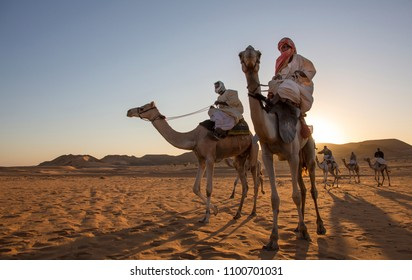 Meroe Pyramids, Sudan- 19th December, 2015: sudanese men on their camels in a desert of Sudan